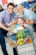 Family drives cart with food and son with watermelon