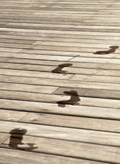 Footsteps on a pier closeup