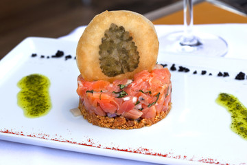 Salmon tartare, biscuit and sauce