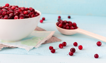 Frozen Cranberries in Bowl on blue desk