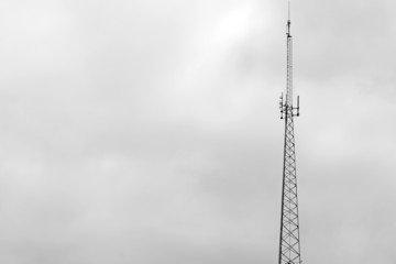Cell phone telecommunication tower,overcast sky,copy space