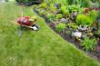 Leinwanddruck Bild - Garden work being done transplanting celosia