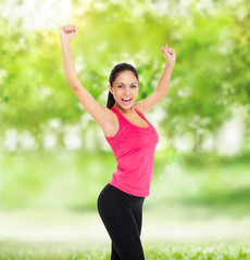 sport fitness woman excited smile raised arm up