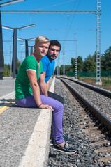 Two young men sitting on the platform