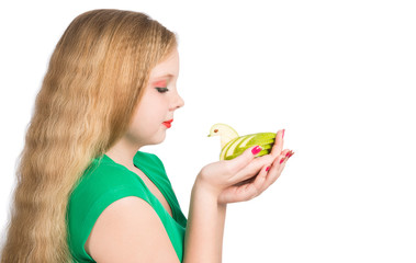 Attractive teen girl in a green t-shirt holding carving green ap