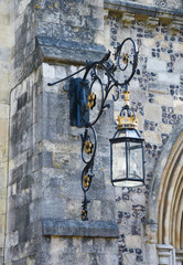 Ornate lantern on a stone wall
