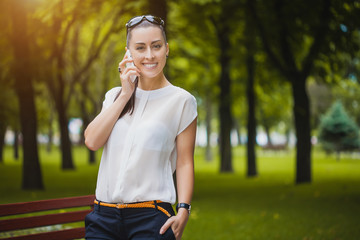 Young Woman with smartphone in the park