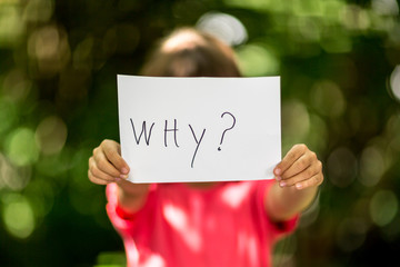 Girl with Why sign