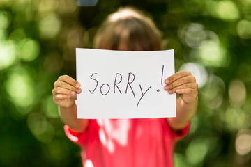 Girl with Sorry sign