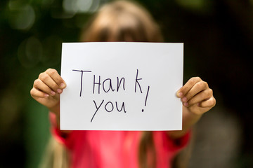 Girl with Thank You sign