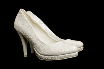 Bride shoes isolated on the black background