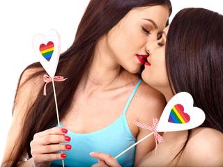 Two lesbian women with heard  in erotic foreplay game