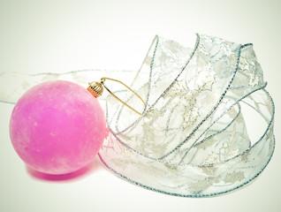 Pink velvety New Year's ball and elegant tinsel