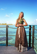 young beautiful woman on a wooden platform over sea