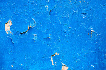 Blue cracked oil-painted surface with rich texture