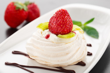 Meringue nest with strawberry
