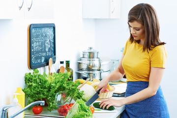 Woman in home kitchen cooking bio diet