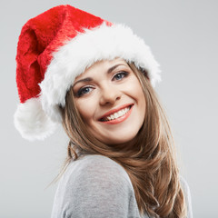 Beautiful young woman Santa Claus hat close up face portrait.