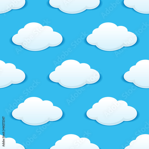 White fluffy clouds in a blue sky seamless pattern