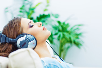 Sleeping woman at home with headphones