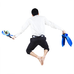 Businessman with snorkeling gear jumping
