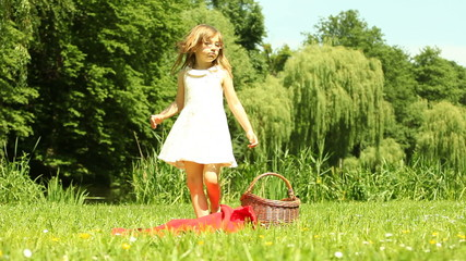 Little girl child kid dancing on the meadow
