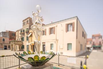 Glass statueof woman on Murano or Burano island