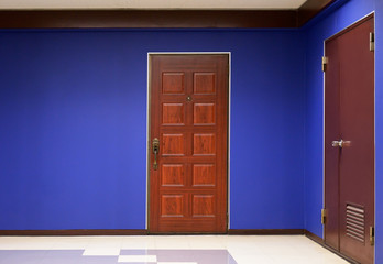 Apartment door and blue wall