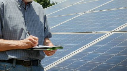 Expert Engineer Inpects Solar Panels
