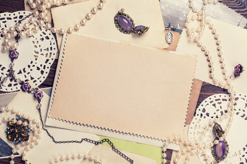 old paper sheets surrounded by retro women's accessories