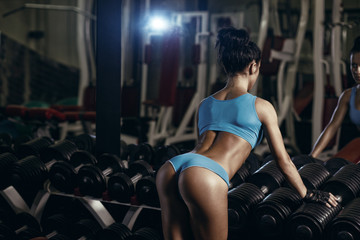 brunette sexy fitness girl with perfect body in the gym