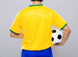 Brazil football player hold soccer ball