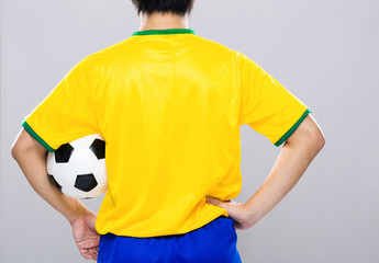 Back view of sport man hold football