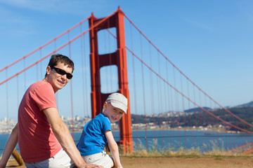cheerful family of two enjoying golden gate bridge in san franci