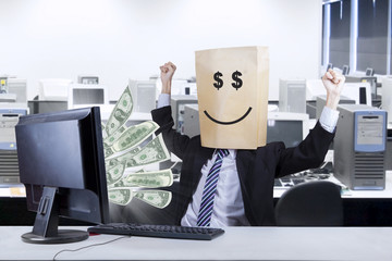 Happ face of businessman looking money