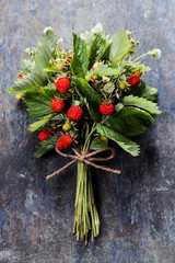 fresh Wild strawberries on wooden background