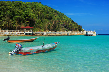 Serene view of the speedboats on the beach, Perhentian Island,