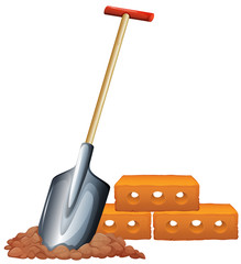 A shovel and bricks