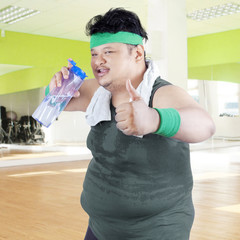 Overweight man drinking water 1