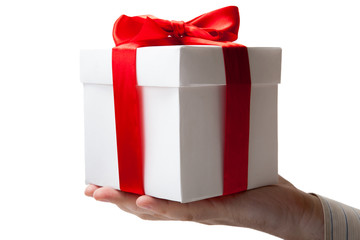 white gift box with red ribbon in hand