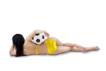Rearview of sexy woman with ball isolated