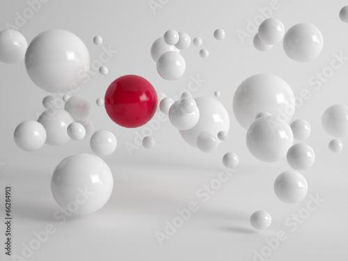 Single red ball amongst floating white balls