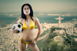 Sexy model holding soccer ball