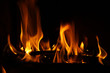 Fire in a fireplace, fire flames on a black background