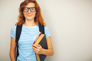 Portrait of Young smart student with books.
