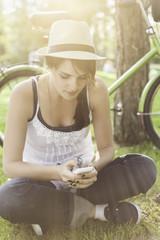 Beautiful girl using smart phone in park