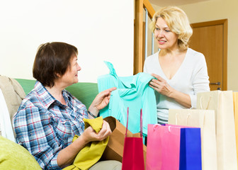 women talking on their purchases
