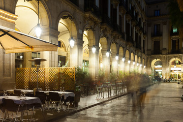 night view of Placa Reial with restaurants in Barcelona