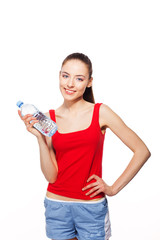 happy sporty woman with bottle of water. isolated on white