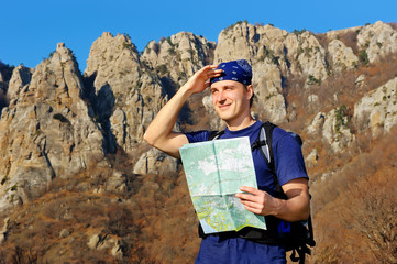 man backpacker looking to the mountains